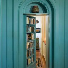 Turquoise bookshelf doorway