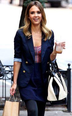 Jessica Alba in a navy blue blazer and skirt.