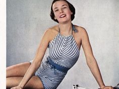 ($1.00) Knit this vintage swimsuit in a chevron pattern. From the 1940's this retro classic has a timeless look including a halter top and a low back. Cords at the neck and waist plus a tight crocheted all around the sides and back to help keep it in shape. This suit is designed to fit a 33-35 inch bust and has a tension of 9 stitches to an inch, which is a slightly tighter gauge than the standard 8 stitches per inch with the same, fingering weight yarn.