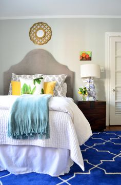wall colors, rug, texa, cobalt blue, white bedding, bed linens, bold colors, bedroom
