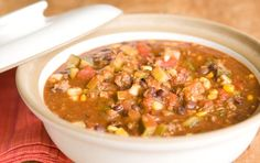 Mexican Taco Stew // An easy-to-throw-together, affordable stew that feeds a crowd. Top bowlfuls of this beefy tomato and corn stew with dollops of sour cream and spoonfuls of your favorite salsa. A great one-pot meal!