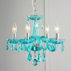 "Color Crystal Mini Chandelier Enjoy the sparkle from this crystal mini chandelier! Measuring 16"" in diameter, this little gem is just right for a powder room, bedroom or walk in closet. Available in several colors to fit your distinct personality, with Turquoise, Purple, Blue, Red, Black, White or classic Clear crystals. Ships complete with matching colored crystal and chrome ceiling canopy and 6' of chain."