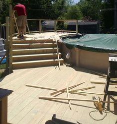 Deck stairs..... Nice  Above ground pool deck.