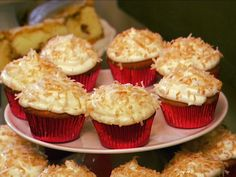 Food Network invites you to try this Coconut Cupcakes with Coconut Cream Cheese Frosting recipe from Patrick and Gina Neely.- This looks so good-Yummy!
