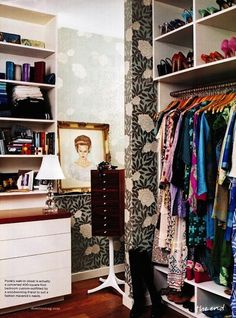 there is something so glamorous about a wallpapered closet....