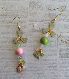 Pink and Green Spectra Beads, Lady Bug, Bee, and Propeller all purchased from B'sue Boutiques, 3mm Green and Pink Crystals also make up these sweet Asymmetrical Earrings for August Challenge .. Designed by .. Jann Tague .. Clever Designs .. https://www.facebook.com/JewelsByJann