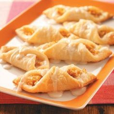 Ingredients  •1 cup butter, softened  •1 package (8 ounces) cream cheese, softened  •2 cups all-purpose flour  •1-1/2 cups finely chopped peeled apples  •1/4 teaspoon ground cinnamon  •ICING:  •1 cup confectioners' sugar  •4-1/2 teaspoons 2% milk  •1/2 teaspoon vanilla extract https://www.facebook.com/TotallyRecipes