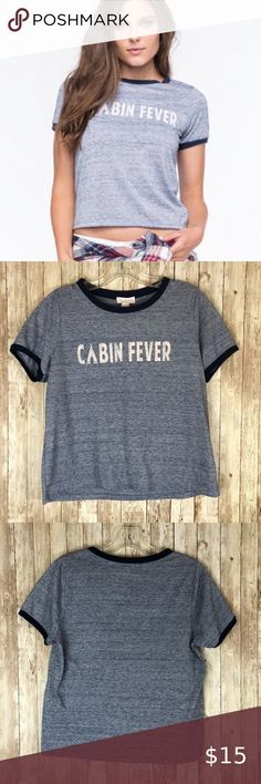 "Tilly's Full Tilt ""Cabin Fever"" cropped tee Talk about the perfect quarantine tee! This longer ringer cropped tee is perfect to wear on your Instagram Live or YouTube video. Color is a heathered medium blue with navy ringer accents around the crewneck and sleeves.   Measurements when laid flat: armpit to armpit: 19"" length: 20"" bottom opening: 20""  88% polyester/22% cotton - machine wash cold Full Tilt Tops Crop Tops"
