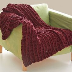 The Redwood Waffle-ghan in a beautiful deep burgundy uses a waffle crochet stitch to give it a luscious texture. | AllFreeCrochetAfghanPatterns.com