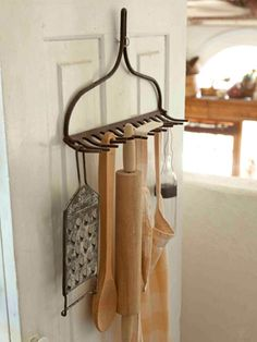 Hang an old rake head on a kitchen door to create an easy-access spot for other cooking utensils, aprons and more.