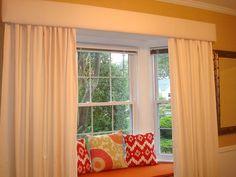Cornice and drape panels for bay window