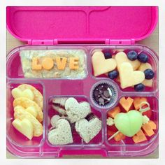 A very special #yumbox lunch for my little valentine! Featuring: Nutella 'heartwiches', dairy-free cheese hearts & rice crackers, vegetable frittata finger, melon hearts & blueberries, tomatoes, carrot hearts & Cupid's bow grape, dairy-free choc chips. school lunch, bento lunchbox, lunchbox idea, yumbox lunch