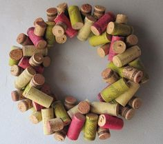 wreath  If, like me, you find yourself with more wine corks than you'd care to admit you have, this is a perfect project to tackle. Autumn is the big harvest season and that includes wine - which we all love to enjoy, right? Sip on a glass as you admire this simple, yet totally gorgeous Autumn wreath above your mantle.