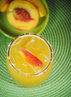 Peach Margarita - makes 4     salt  lemon wedges  1 cup tequila  1 cupfreshpeachjuice (about5 peaches)  1/3 cup fresh lemon juice  1/2 cup Cointreau  ice cubes