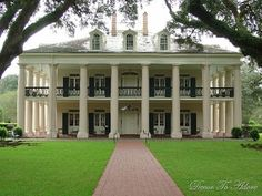 Southern plantation home. Columns, porches, shutters. Enough said.