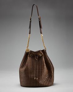 beach day bag:)     Woven Drawstring Bag by Stella McCartney: Originally designed to tote bottles of champagne, the bucket bag is now a top fashion trend #Drawstring Bag #Stella_McCartney