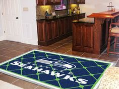 I think this could work in the entertainment room http://www.plainandsimpledeals.com/prod.php?node=12819=Seattle_Seahawks_Rug_5x8_60#