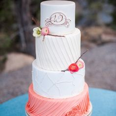 Droaped white & coral wedding cake with fresh ranunculuses and twigs   Byron Roe Photography   Sweet & Swanky Cakes