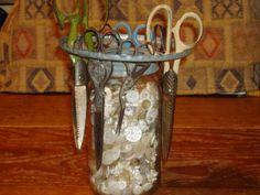 Scissors in an old chicken feeder