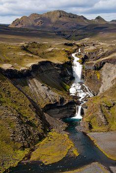 Ofaerufoss waterfall on Eldja volcanic rift, Iceland