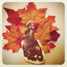 Footprint turkey and fall leaves! We are color photocopying and laminating it for a thanksgiving placemat! Would be cute in a frame too.