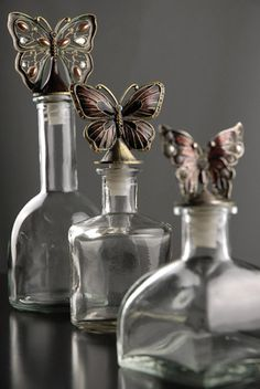 glass bottles with jeweled butterfly stoppers