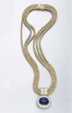 A SAPPHIRE AND DIAMOND PENDANT NECKLACE  The pavé-set diamond oval pendant, suspended by a cabochon sapphire and diamond hoop, to the triple white and yellow gold neckchain, 46.1 cm.