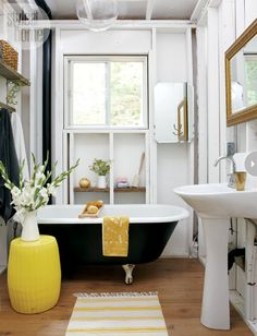 black tub with yellow accents #bathroom