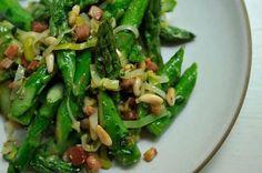 absurdly addictive asparagus: pancetta, leeks, garlic, citrus and pine nuts