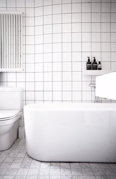 Classic white bathroom - add a set of bright towels and a bath mat for a pop of colour!