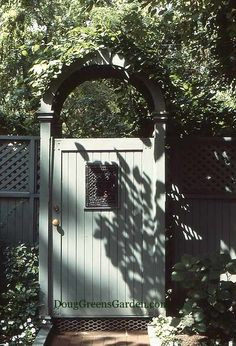A closed gate adds mystery to the garden