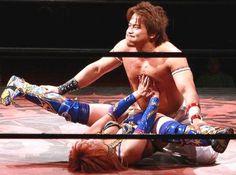 Miss Kana wrestling a man.