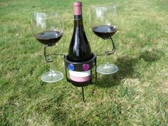 want this!! Picnic Wine Bottle and Glass Holders.