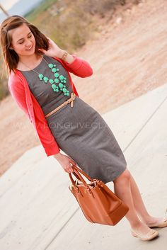 Adorable work outfit for women- grey sheath dress, coral cardigan, turquoise  j crew necklace, tan belt