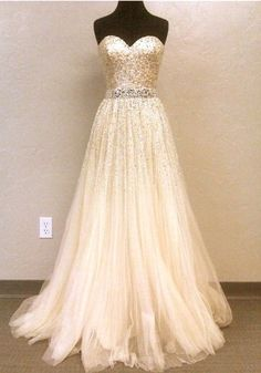 Love the bling!    After doing some research, this dress is apparently a vintage Dior gown..
