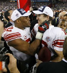 Michael Strahan and Eli Manning after winning the Superbowl