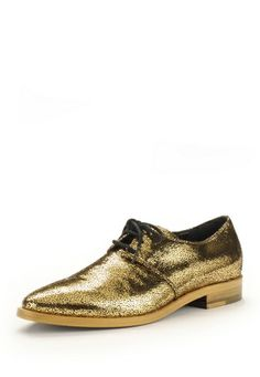 Make eyes sparkle this Autumn/Winter 2013-14 with Vivienne Westwood's vibrant pointed shoes. Crafted in leather, these charming lace up shoes are constructed with gold foiled suede uppers and leather soles.