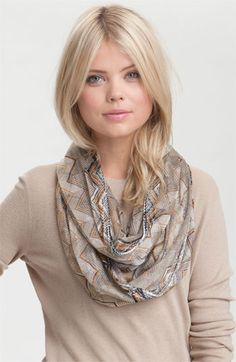 Infinity scarves are still hot, especially this one by Missoni.  You can DIY infinity by tying the ends. Voila!