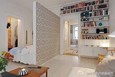 Add an accent wall (wallpapered or painted) as a room divider in a studio apartment. small apartments, design room, design homes, studio apartments, apartment design, wall dividers, small spaces, accent walls, room dividers
