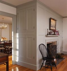 LIke built-in cabinets on the end. Colonial fireplace with inset paneled surround and built-in cabinetry on end