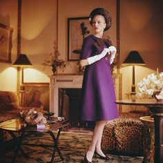 Anne Larsen in violet wool coat-dress and straw roller by Dior, photo by Mark Shaw in the Paris smoking room of Francine Weisweiller as decorated by Madeleine Castaing, 1960.
