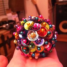 Sequins and stick pins in a styrofoam ball- lots of work but rewarding in the sparkle of it all!