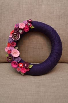 Yarn Wreath - VALENTINE'S DAY  - 12 inch Purple Yarn Covered Straw Wreath with felt Flowers and Button Accents. $50.00, via Etsy.