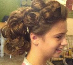Loopy hairstyle. Got Bobbypins?