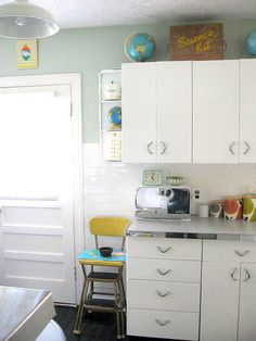 Carolyn's 1940's Kitchen Makeover - Salvaged metal cabinets and formica countertops.