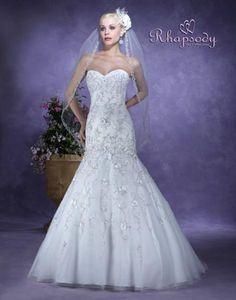 Wedding Dresses, Bridal Tiaras, & Bridal Veils at Symphony Bridal Collections