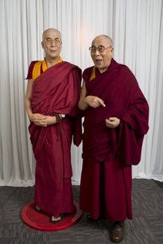 DALAI LAMA LAMA DING-DONG!!!The Dalai Lama visits Madame Tussauds and poses with a wax figure of himself in Sydney, Australia. Photograph: Getty Images