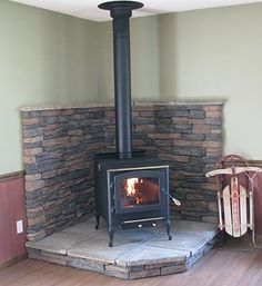 corner wood stove | Webmasters notes - the finished stove and hearth look beautiful and ...