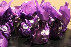 Evil Purple Minion party favors. Used a purple plastic bag inside and on the outside a sheet of purple tissue paper from Target with free printouts for the face found on my board. Inside were bubbles, trading cards and a pair of Minion shoe charms ordered on ebay.