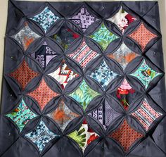 Cathedral window quilt tutorial, blogged here: http://hyena-in-petticoats.blogspot.com/2007/08/cathedral-window-quilt-tutorial.html